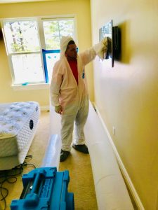 water damage restoration crew in residence